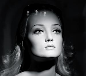 Woman: plastic doll face beauty