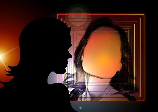 Woman looking into mirror with empty face silhouette