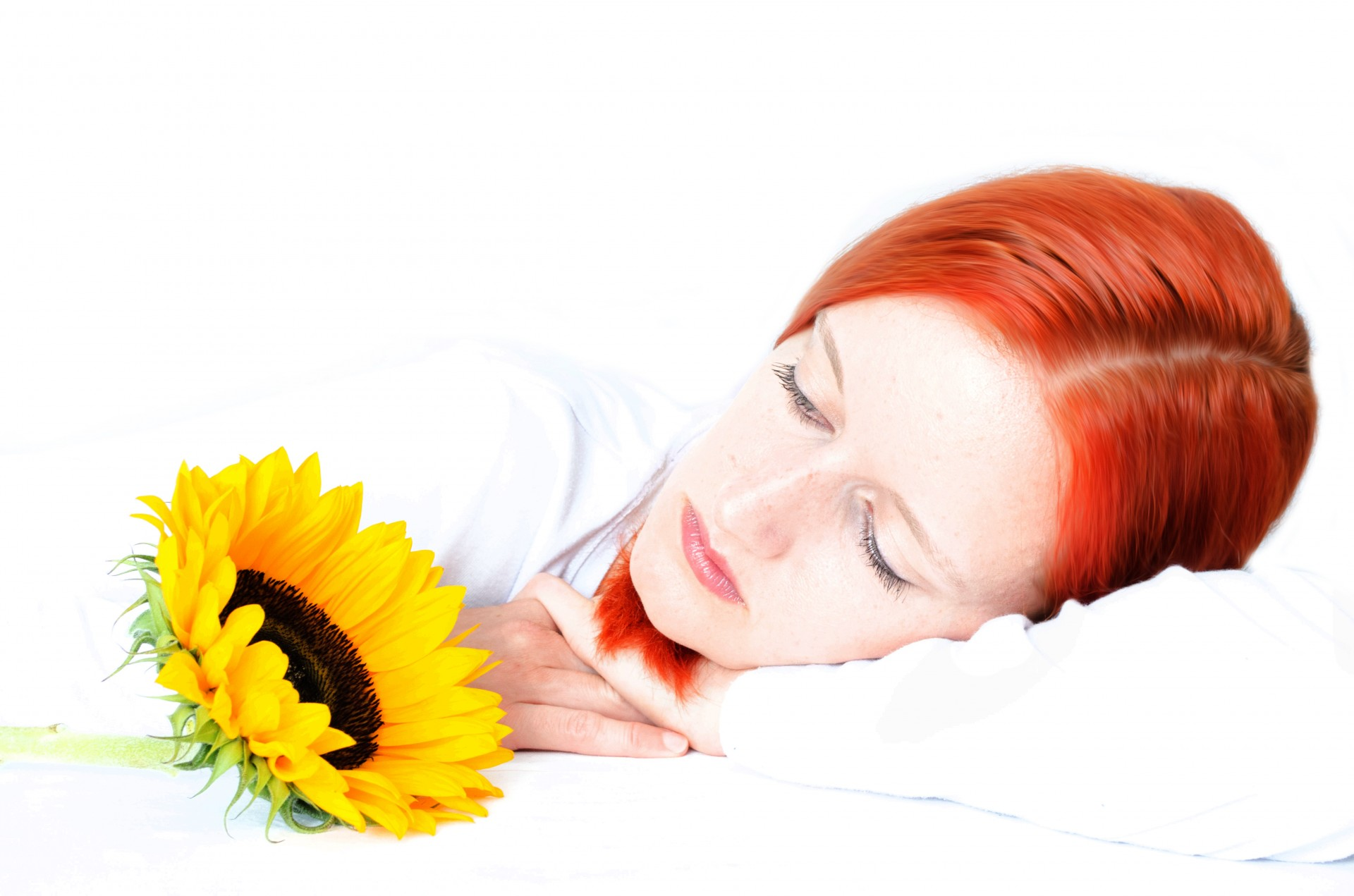 Woman with red hair and sunflower