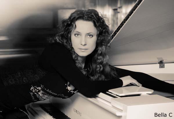 Bellla C, Singer and Piano Player in front of her instrument